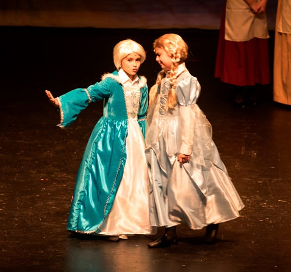 Here are the young Princesses Elsa and Anna played by MaKenzie Wynn and Corlyn Stauffer.