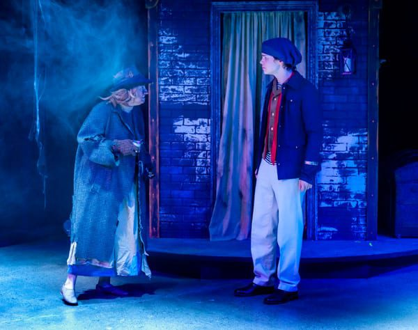 Maddie Beer-Penwell, as the Beggar Woman, and Drew Owens as Anthony Hope meet on the Streets of London.